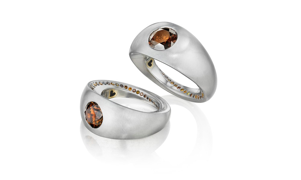 Lover's Rings GIA certified natural 3.17 ct orangey-brown diamond, size 10. GIA certified natural 2.51 ct orangey-brown diamond, size 9. Both: smaller orangey-brown diamonds, platinum, and 18K yellow gold.