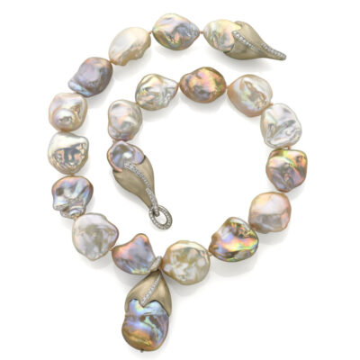 Strand of freshwater baroque cultured Pearls with 18K white gold and Diamonds and a freshwater baroque cultured Pearl pendant.