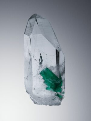 Gem quality emeralds growing inside a quartz.