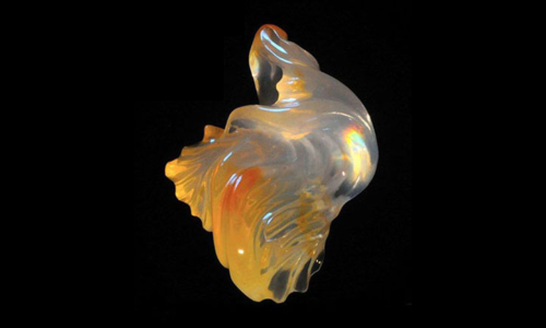 Hand-carved fire opal. 47 x 37 x 27 mm. 114 ct.