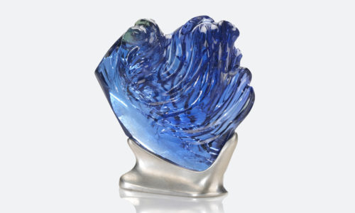 The 725 ct, L'Heure Bleu is the world's largest fine color natural unheated Tanzanite carving.